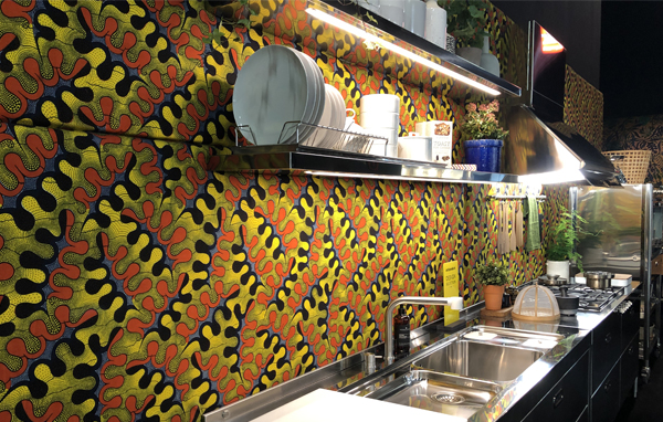 Living Kitchen Show, Open Shelving against a bold wall pattern